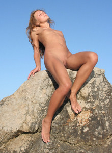 Teen nudist on the big stone in the water