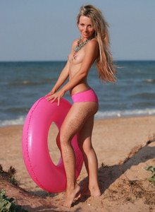 Cute puffy nipples young blonde at the beach in pink sexy bikini uses safety ring