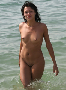Puffy nipples nudist brunette in the sea