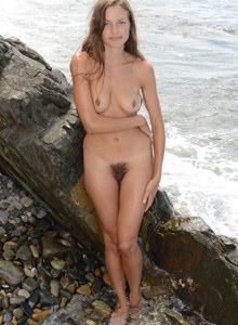 Young hairy pussy girl at rocky shore