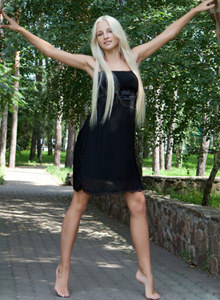 Sexy blonde visiting summer house in black dress