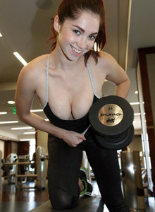 Jazz Reilly is in the gym in tight black spandex and top