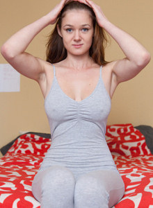 Busty Chelsea Dawson is in her bed in tight grey suit