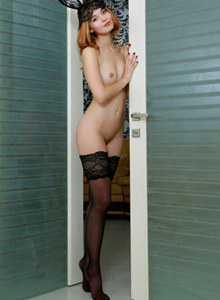 Passionate sexy redhead in black stockings