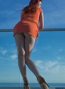 Glamour redhead in orange dress