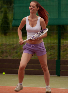 Amazing tight clothed redhead playing tennis