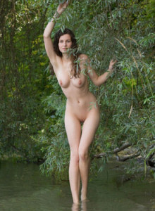 Exciting busty nude Susann with perfect body puffy nipples having fun in the lake