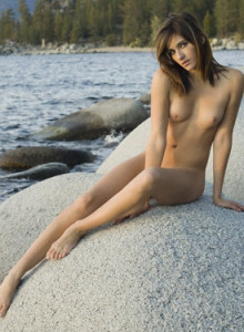 Exciting brunette Marianna going nude on the big rock at the seashore