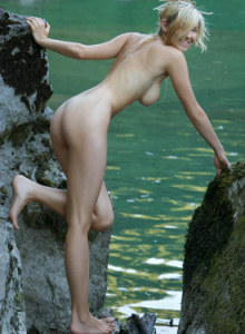 Beautiful sexy Corinna nude on the rocks