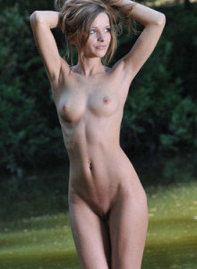 Exciting Conny is nude in the river