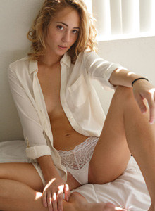 Wonderful young Dallas Mills in sexy lace white underwear poses on the bed