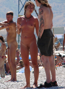 Beach swimming nude and topless girls