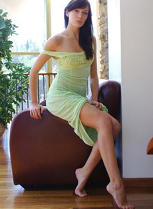 Brunette hottie in sexy green dress