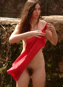 Exciting hairy beaver hottie in red dress going nude at the river