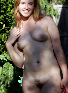 Hairy pussy Bree in green suit takes it off to have pleasure