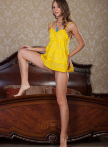 Passionate Olina in sexy yellow dress has the nipples erected