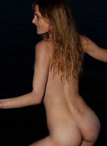 Puffy nipples surfer Celine is on the beach in the evening flashing her hairy pussy and tasty petite ass