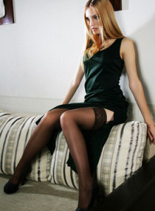Stunning sexy goddess in long dress and stockings is showing her perfect nude body