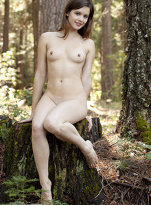 Teen naturist in white sexy dress going nude in the forest